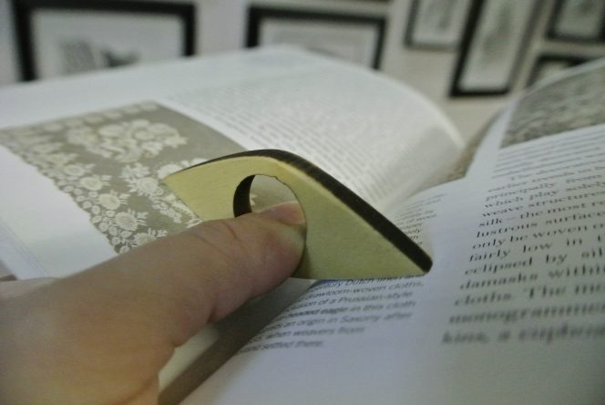 book holder holding open book